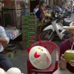 A pause to drink fresh coconut juice in Ho Chi Minh city