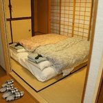 Bedroom with futons, yukatas, and slippers