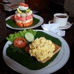Scrambled eggs on toast + fruits + tea