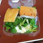 club sandwich on foccacia bread with Caesar salad