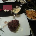 250g/9oz fillet steak with mushroom sauce and potato wedges.