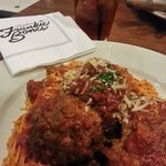 Spaghetti and Hand rolled veal, pork & beef over herbed angel hair w/ bolognese and tomato sauce