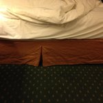 Crumpled and stained bed skirt