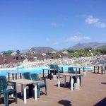 Terraza ideal con piscina y tobogán