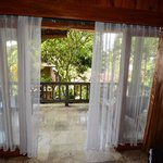 sliding doors with curtains to the balcony