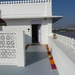 Entrance/patio to a Palace room with flower rangoli