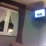 Old-fashioned TV in old-fashioned hotel.