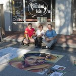 Street Painter Jennifer Nichols Chaparro with the owners.