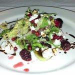Mixed greens salad with mint qunioa, pomegranates, blackberries