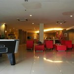 The lobby. Front desk, seating, pool table,massage chairs,ironing board, TV, free brochures and
