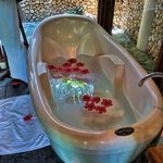 Tub decorated with flowers upon arrival