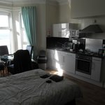 open plan dining, kitchen and double bed