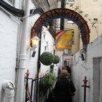 A narrow alley leads to the cafe