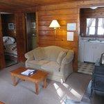 Living room, bedroom through door to left.