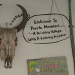 """Nearby Puerto Morelos: """"A drinking village with a fishing problem"""".  Expect the best fish ever h"""