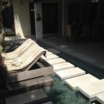 From entrance with pool on left, living on right, cute stepping stones