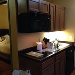 The second room and kitchen of the 2-queen 2-room suite