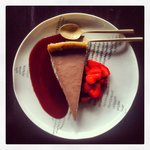 raw chocolate pie with strawberry coulis