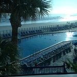 View of beach and pool from room