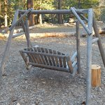 outside wooden swing at backdoor