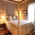 Ambrose Bierce Suite with a Queen bed and attached bathroom and living room