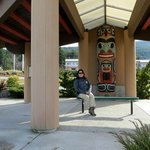 Me in front of cedar-carved totem pole