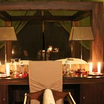 Intimate dinner for two under the stars on the verandah of our tent