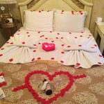 Our bed decorated with rose petals