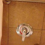 Shower controls with screws in them