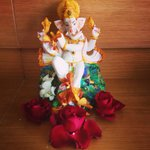 The housekeeping staff honored Ganesha in my room by placing flowers.