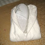 Bathrobe and slippers waiting on the bed