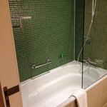 Wonderfully deep bath and power shower in a gorgeous bathroom
