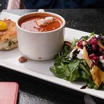 Tasty crab cake and plum tomato soup