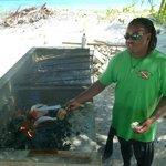 Devin roasting coconut for us