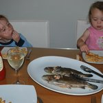 kids tucking in to their catch