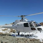 Helicopter on top of South Island NZ Peak