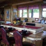Kitchen has 5 chairs around eat in bar