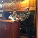 Kolin mixing up a drink at the bar area ~ Great Host