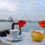 View of Piazza San Marco with glasses of Spritz from La Giudecca