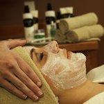 Guest enjoying a facial at the spa