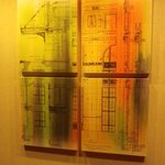 Some appropriate decor beside the elevators shows the buildings original drawings. Nice touch.