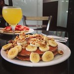 Famous Oatcakes topped with bananas! Don't forget your mimosa!