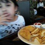 Enjoying Fish and Chips.