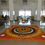 A mandala made of flowers in the lobby for Diwali