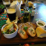 Trinity Steak, steamed vegetables, baked potatoes, baked bread, and a Guiness!