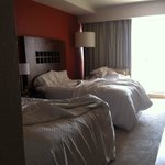 Room with two double beds, which are very small