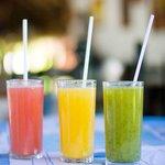 Natural grapefruit, orange and green juice