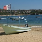 la playa, las barcas.