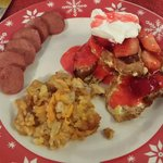 Croissant french toast, turkey sausage, and 1833 potatoes