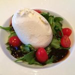 The amazing Buratta! With pesto, balsamic, arugala, and tomatoes. Yummy!